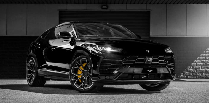full frontal view black urus with tuning