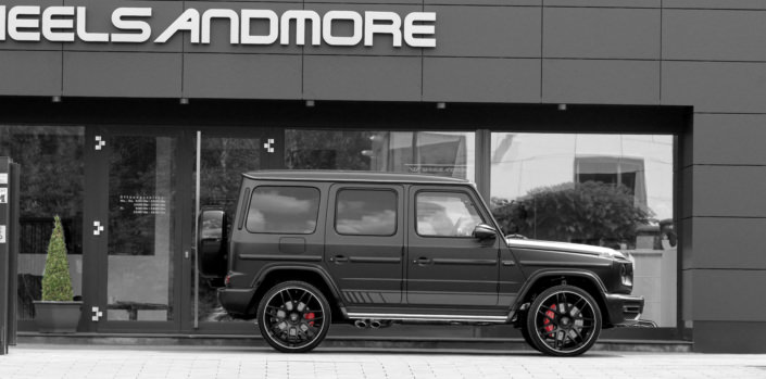 full side view black g63 amg with 24 inch wheels