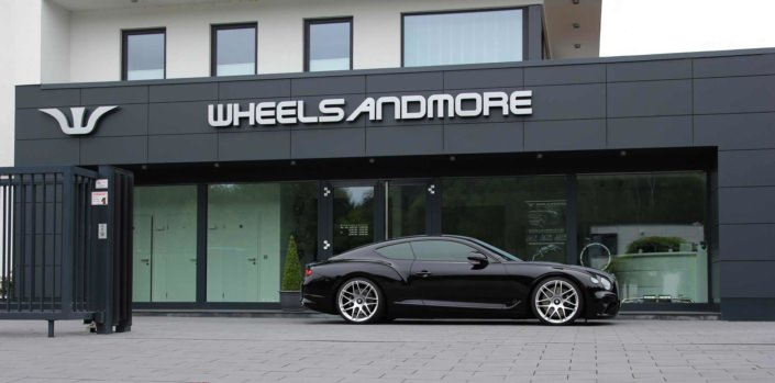 side view black bentley with tuning components fro wheelsandmore
