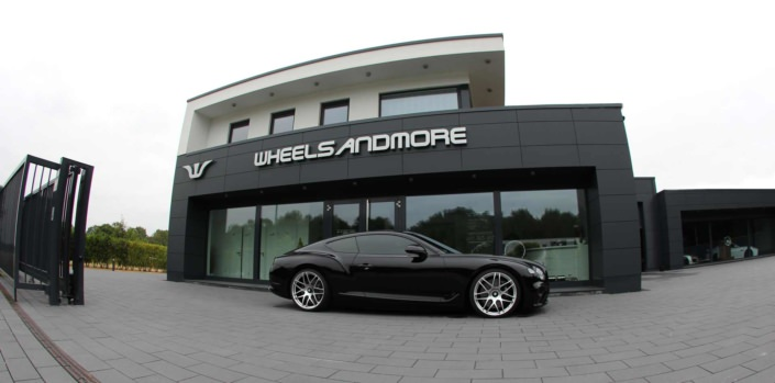 fisheye view bentley new continental gt by wheelsandmore in from of headquarter in germany