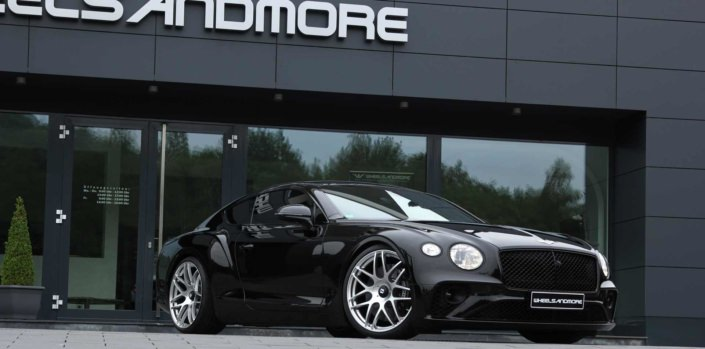 front side view of bentley new continental gt 3s in front of wheelsandmore headquarter
