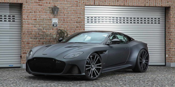 side front view dbs in front of a garage wearing 22 inch fiwe wheels from wheelsandmore