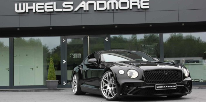 front side view black continental with tuning products from wheelsandmore