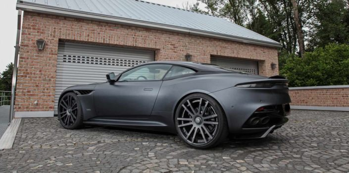 side rear view anthracite dbs superleggera with massive 22 inch wheels