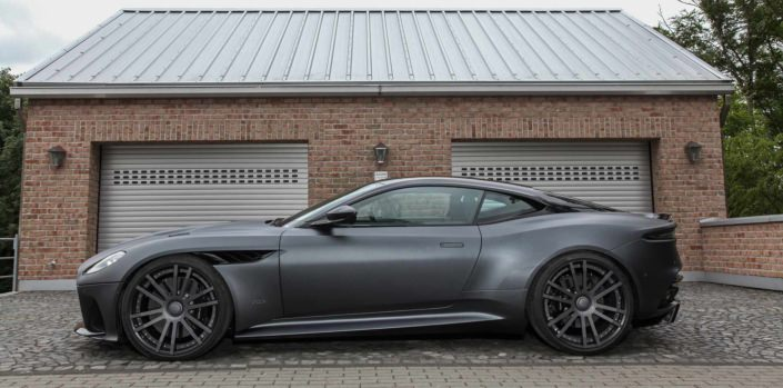 side view matte grey dbs superleggera with 830hp and 22 inch wheels