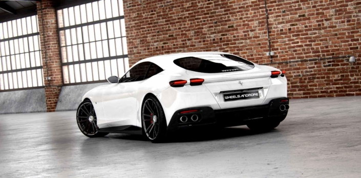 rear view of white ferrari roma waering individual customized fiwe wheels from wheelsandmore