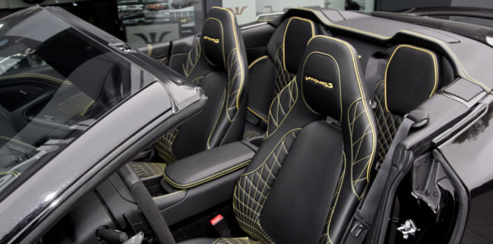 leather stitching aston martin black yellow volante