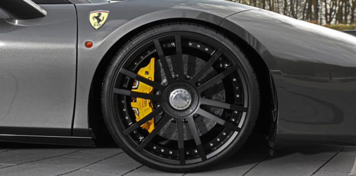 close up matte black fiwe wheel on ferrari 488