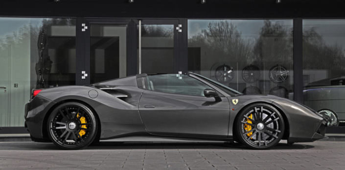 grey ferrari 488 gts with 21 inch wheels and suspension spring sideview