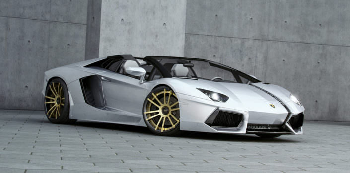 silver aventador roadster with gold black fiwe wheels