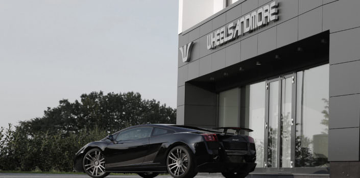 rear view of black superleggera with 20 inch concave fiwe wheels