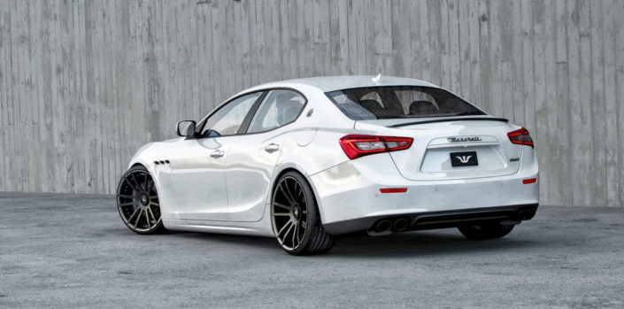 white ghibli rear seide view with 22 inch fiwe wheels and lowering suspension
