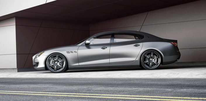 quattroporte tuning side view with black 22 inch 6sporz rims