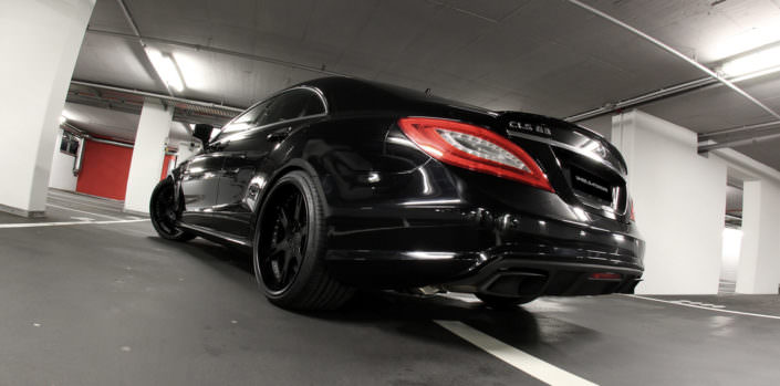 rear side view all over black tuned mercedes cls 63 amg