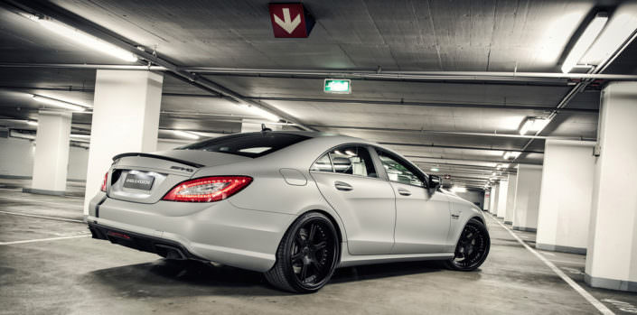 all black 20 inch 6sporz wheels on grey cls63amg in garage