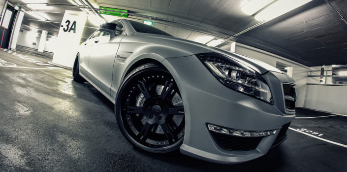 grey cls side front close up 20 inch wheels black multipart