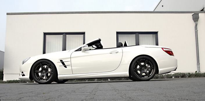 white sl350 mercedes wearing 6sporz wheels in matte black