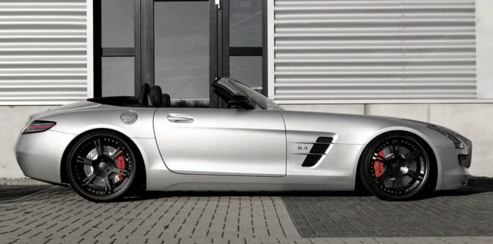 silver mercedes sls amg sideview with black 21 inch 6sporz wheels