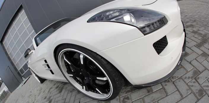white sls amg front side view with 21inch 6sporz wheels with individual finish black and white
