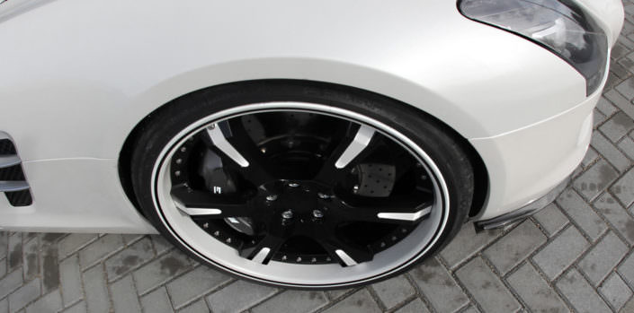close up handcrafted 6sporz wheel with multicolor finish and black outline on white outer lip