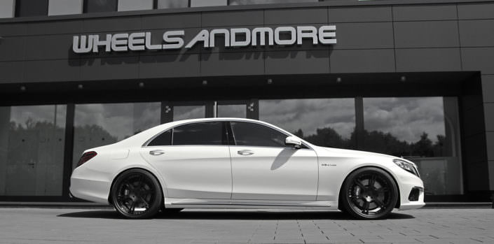 side view mercedes s63 amg white with black wheels