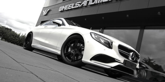 whit s63amg coupe with 22 inch 6sporz wheels in matte black