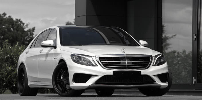 white s63 sedan wearing 22 inch 6sporz wheels in black