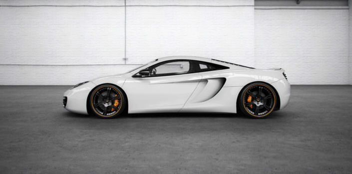 white mp4-12c wearing 6sporz wheels 20/21 inches in black with orange outline